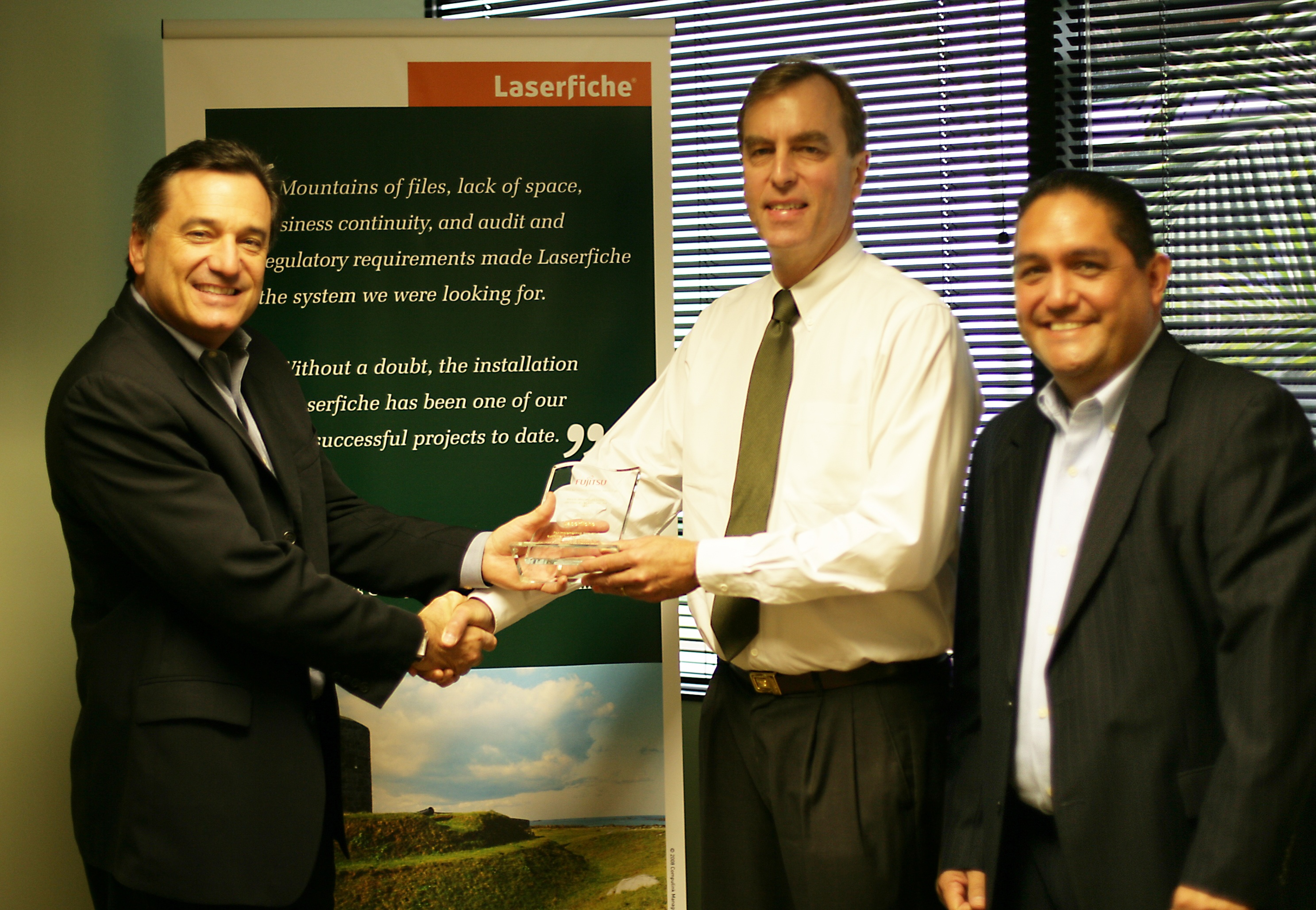Doug Rudolph, VP, Product Management and Business Development, Fujitsu Computer Products of America, Inc. (left) and Robert Esquivel, Jr., CDIA+, ISV Business Development Manager, Western Region Fujitsu Imaging Products Group (right) present Chris Wacker, Laserfiche Senior Vice President Business Development (center) with Fujitsu's Independent Software Vendor Innovative Award.