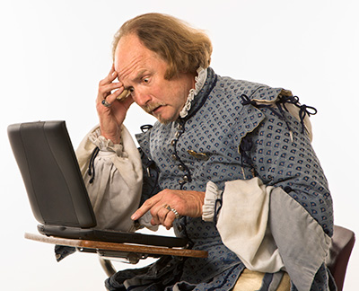 shakespeare with laptop