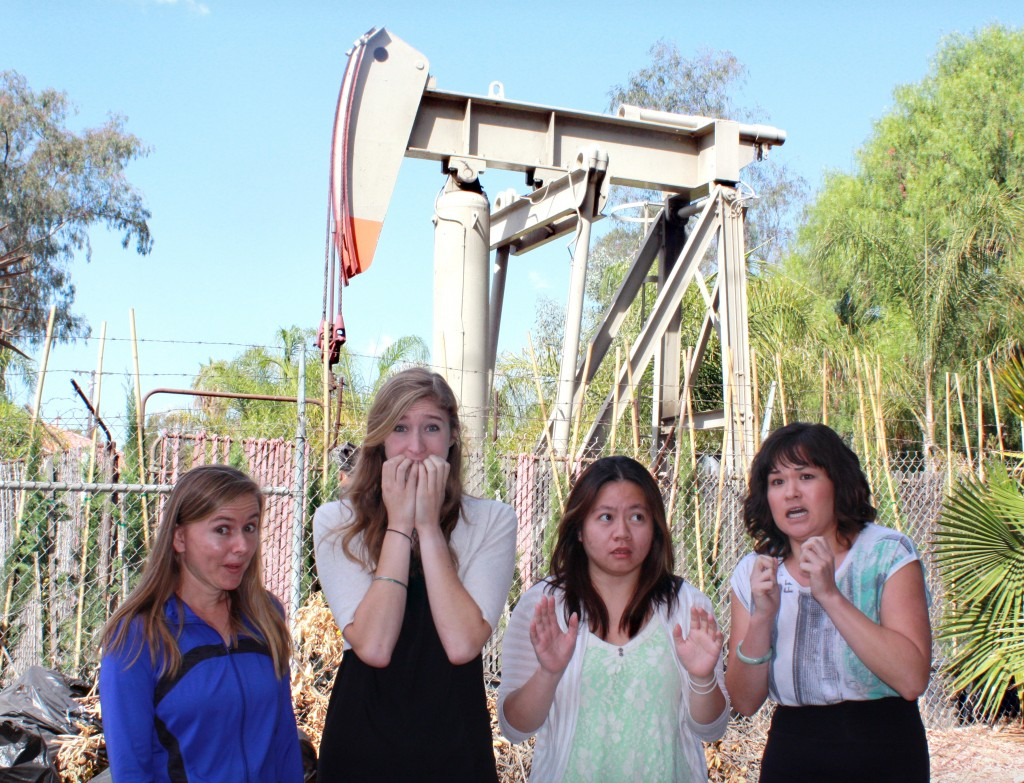 Laserfiche employees stand in front of a nearby oil rig