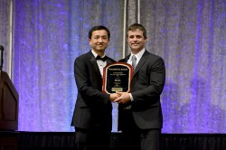 Donny Barstow, President of MCCi, accepts the President's Award from Laserfiche President Karl Chan