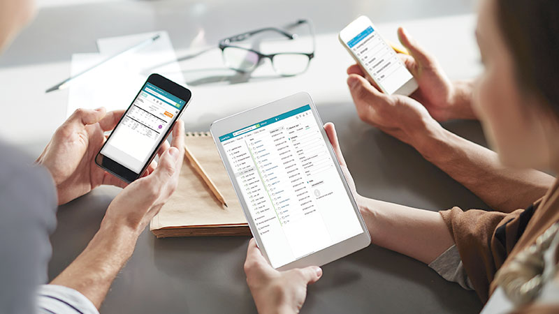 Group of professionals using Laserfiche on mobile devices